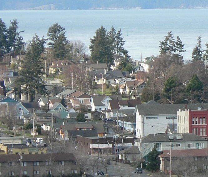 Houses and other buildings with ocean background of Anacortes , Washington.