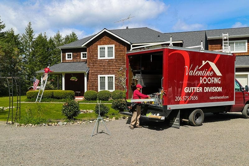Valentine Roofing vehicle and professional roofers, House in background