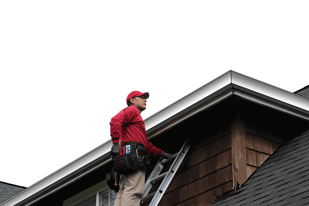 Rain gutter installer on a ladder inspecting gutters.