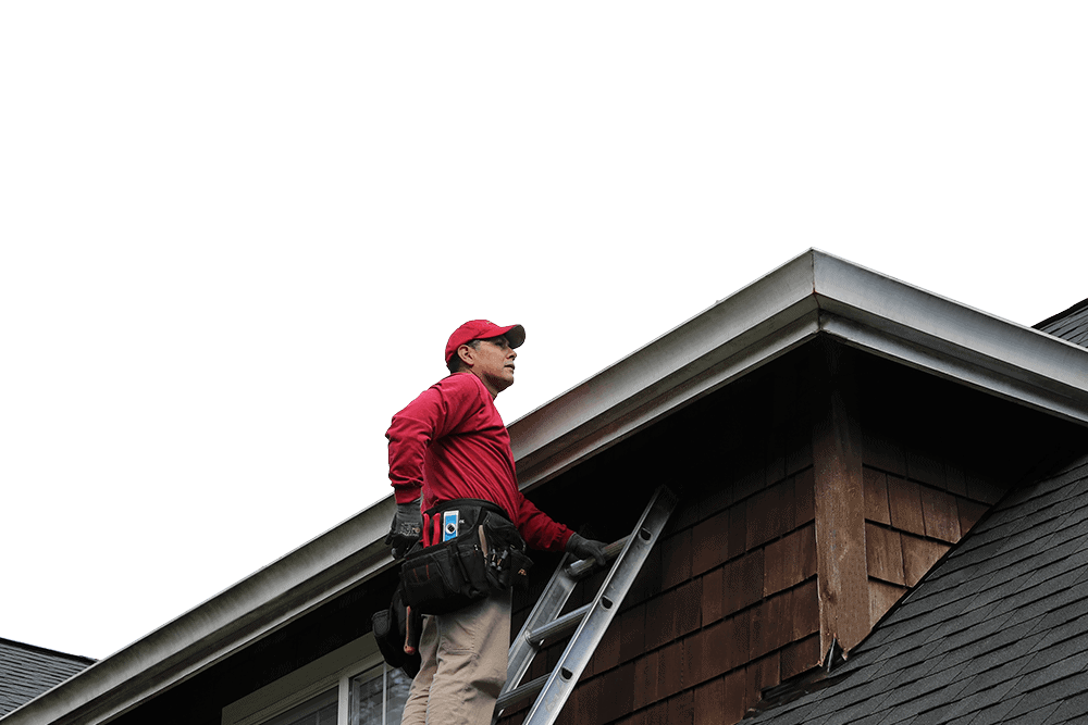 Professional gutter contractor inspecting a new installation of seamless, aluminum gutters.