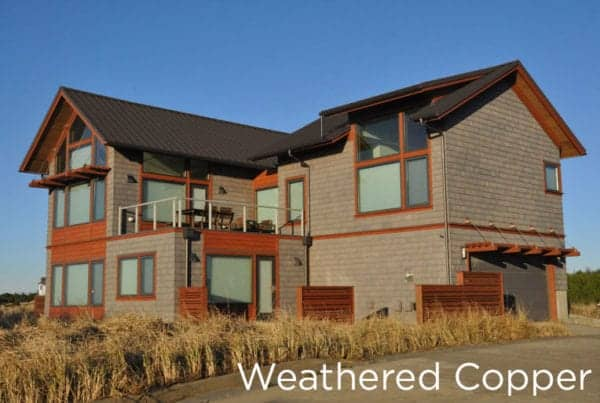 Weathered Copper colored metal roof on a two-story home.