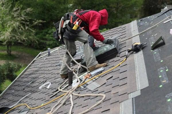Valentine Roofing contractor installing a skylight during a new roof replacement in University Place