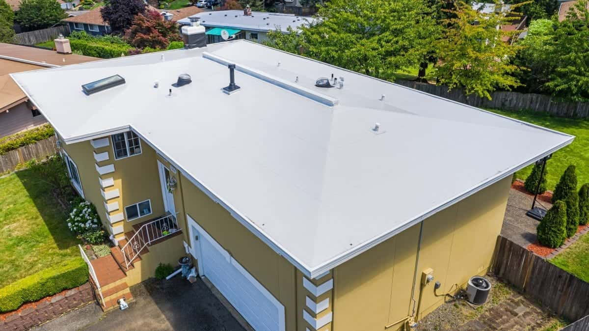Photo of Side View of Modern Roof of House with Flat PVC Roofing, Seattle, WA - Valentine Roofing