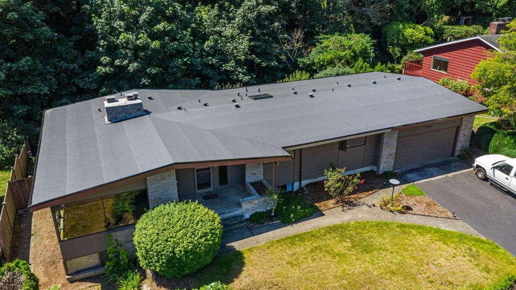 Entire Shot of House with Modern Roof with Flat PVC Roofing, Seattle, WA - Valentine Roofing