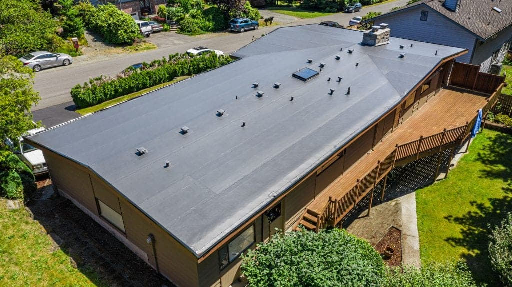 Top View of Modern Roof of House with Flat PVC Roofing - Seattle, WA - Valentine Roofing