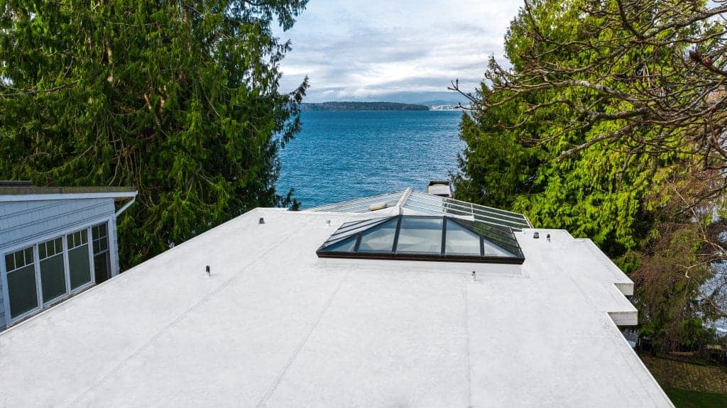 Top View of Modern Roof of House with Flat PVC Roofing with Roof Window - Seattle, WA - Valentine Roofing