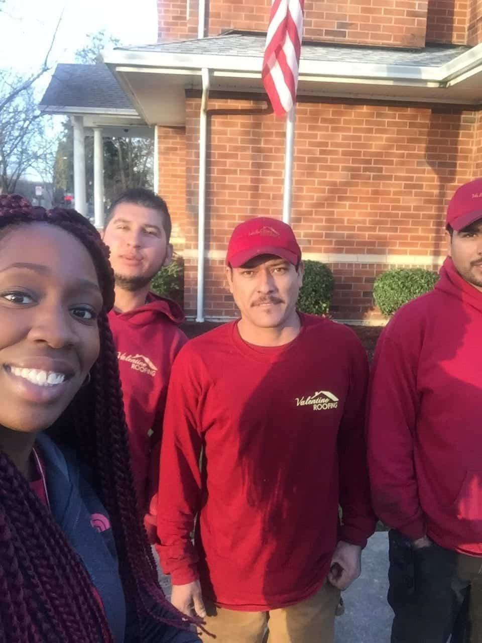A lady homeowner taking selfie with our roofers