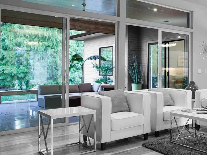 Interior sliding glass doors leading to outside covered enclosed patio.